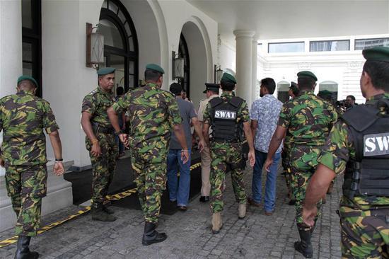 Police work outside Kingsbury hotel in Colombo, Sri Lanka, April 21, 2019. (Xinhua)