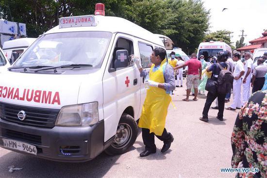 Ambulances are seen outside a hospital in Negombo, north of Colombo, Sri Lanka, April 21, 2019. (Xinhua/Samila)
