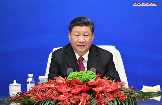 Chinese President and Central Military Commission Chairman Xi Jinping holds a group meeting with the heads of foreign delegations invited to the multinational naval events marking the 70th anniversary of the founding of the Chinese People's Liberation Army Navy in Qingdao, east China's Shandong Province, on April 23, 2019. Xi, on behalf of the Chinese government and military, extended warm welcome to naval officers and soldiers of various countries who are here for the events. (Xinhua/Li Gang)