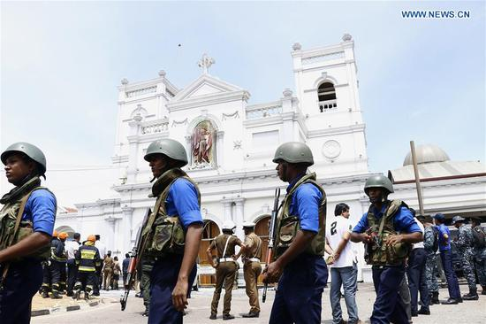 Security staff stand on guard outside the St. Anthony's Church where a blast took place in Colombo, Sri Lanka, April 21, 2019. (Xinhua/A.Hapuarachchi)