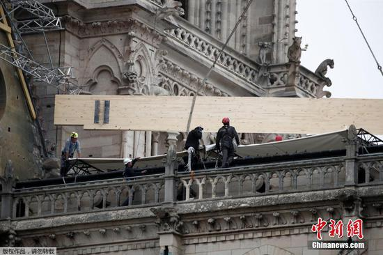 Rain threatens France's damaged cathedral