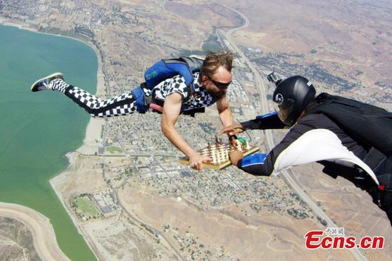 Skydiving while playing chess