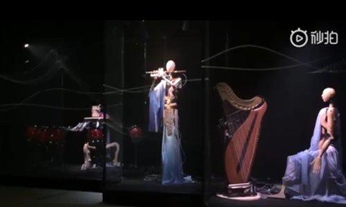 Tsinghua University's special traditional Chinese music band consisting of three robots. (Screenshot photo/Tsinghua University)