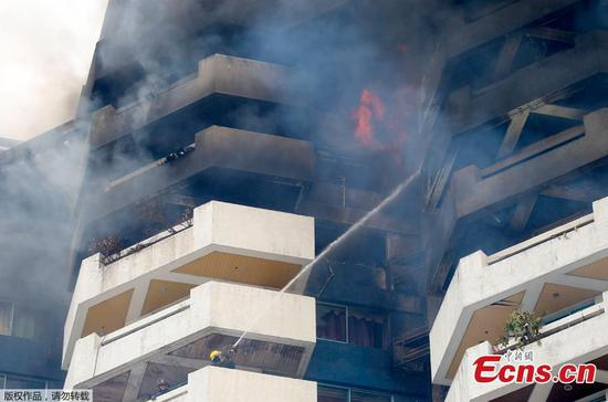 Huge fire at condominium in Philippine capital kills one woman
