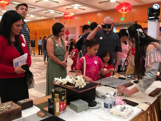 People attends a promotion of the China Tourism and Culture Week in New York, the U.S. , May 4, 2019. (Photo provided to China Daily)