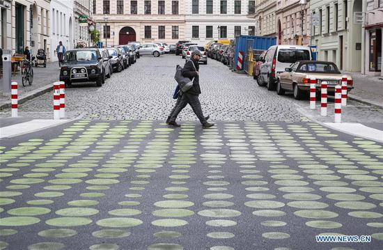 Green dots applied as new street signals in Berlin, Germany