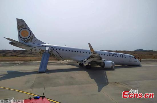 Myanmar Airlines flight lands safely after landing gear failure