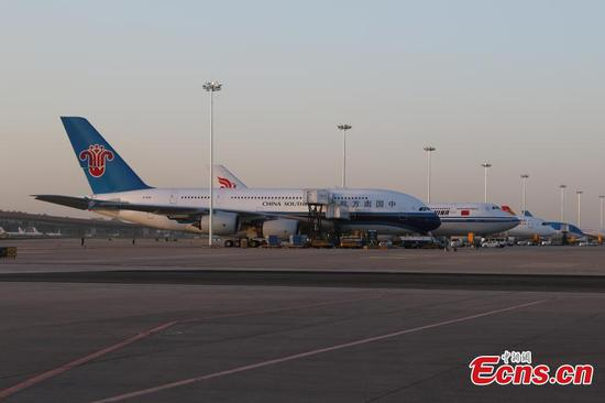 Four aircrafts take test flight at Beijing Daxing International Airport