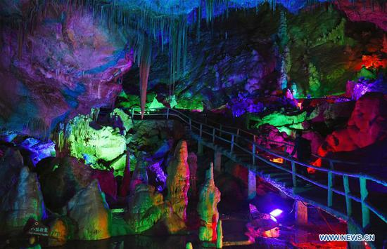Tourists view Wanxiang karst cave in Gansu