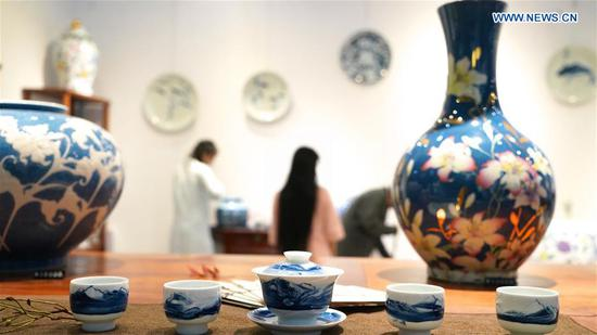 Visitors look at porcelains during the 2018 China Jingdezhen International Ceramics Exposition in Jingdezhen, east China's Jiangxi Province, Oct. 18, 2018. The 2018 China Jingdezhen International Ceramics Exposition attracted over 3,000 exhibitors from nearly 500 global ceramics enterprises. (Xinhua/Hu Chenhuan)