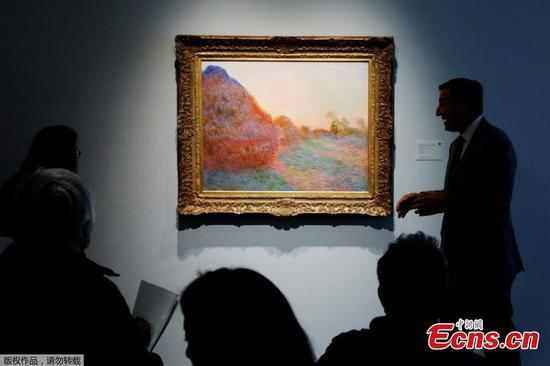 Monet 'Haystacks' painting sells for record $110.7 million at auction