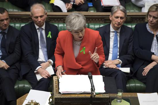 British Prime Minister Theresa May (Front) attends the Prime Minister's Questions at the House of Commons in London, Britain, on May 15, 2019.  (Xinhua/UK Parliament/Jessica Taylor)