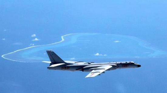 File photo of a Chinese H-6k bomber patrolling Huangyan island in July 2016. /Xinhua Photo