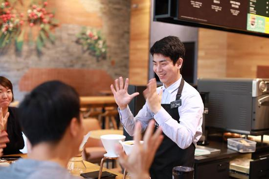 Starbucks opens first store with sign language capability in China
