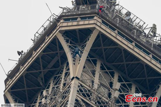 Eiffel Tower evacuated after man tries to climb it