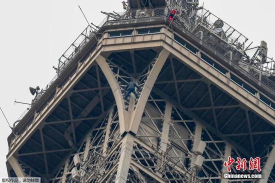A man is found trying to climb one of the pillars of Eiffel Tower, May 20, 2019. (Photo/Agencies)