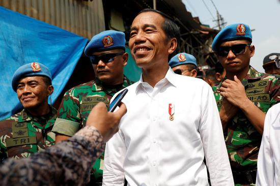 Indonesia's Incumbent President Joko Widodo reacts after making a public address with his running mate Ma'ruf Amin, following the announcement of the last month's presidential election results at a rural area of Jakarta, Indonesia, May 21, 2019. (Photo/Agencies)