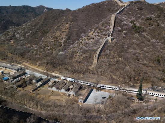 In this aerial photo taken on April 2, 2019, a Line S2 train of Beijing Suburban Railway (BSR) pulls out of Qinglongqiao station of the Beijing-Zhangjiakou railway in Beijing, capital of China. (Xinhua/Ju Huanzong)