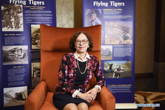 Cynthia Chennault, daughter of late U.S. General Claire Lee Chennault, poses for a picture in front of Flying Tigers posters during the 4th Sino-American Second World War Friendship and Flying Tiger History Conference in Las Vegas, the United States, May 11, 2019. Over the past decades, Cynthia Chennault traveled frequently between the United States and China, dedicated to cultural and people-to-people exchanges, an effort she deemed vital for the friendship long forged by the two nations. (Xinhua/Han Fang)
