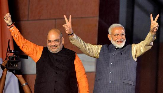 Indian Prime Minister Narendra Modi (R) and Bharatiya Janata Party President Amit Shah greet supporters at the Bharatiya Janata Party headquarters in New Delhi, India, on May 23, 2019. Indian Prime Minister Narendra Modi announced his Bharatiya Janata Party's victory in the just-concluded 17th general elections on Thursday. (Xinhua)