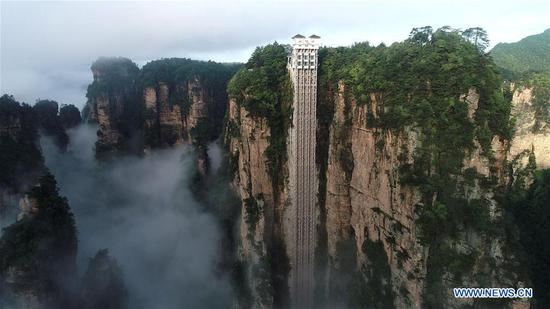 World's highest outdoor elevator shrouded by fog in Zhangjiajie