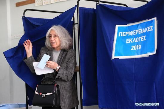 A woman votes at a polling station in Athens, Greece on May 26, 2019. Voters in Greece cast their ballots on Sunday in elections to the European Parliament (EP). (Xinhua/Marios Lolos)