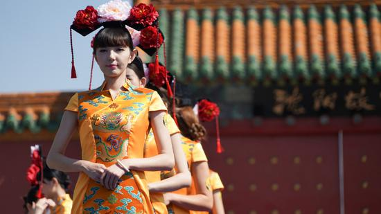 Shenyang Palace Museum will also offer free tickets for 1,636 female tourists who wear a Qipao each day, from May 25-31, 2019.(CGTN Photo)