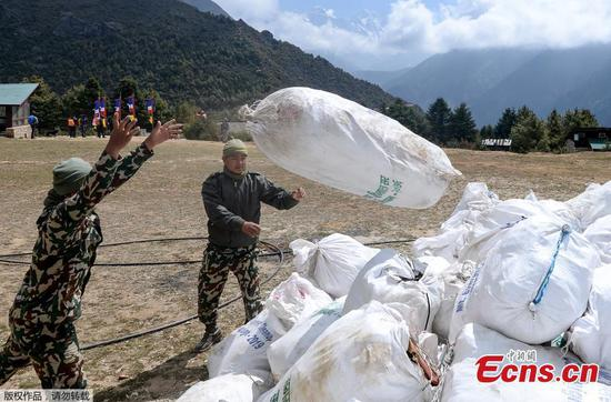 Nepal authorities clear tonnes of trash from Mount Everest