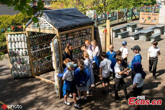 Kids build recycled classroom from 3,000 bottles