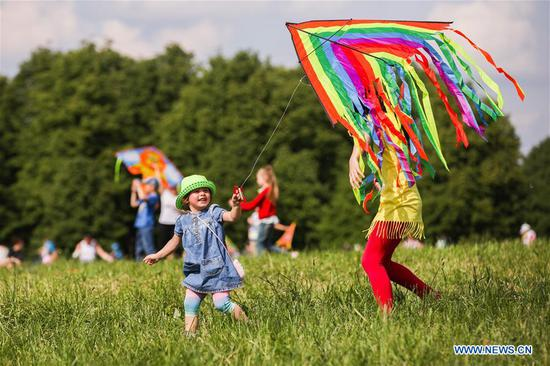 People fly kites during Motley Sky festival in Moscow, Russia