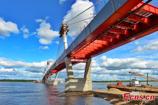 Two sides of China-Russia highway bridge connected
