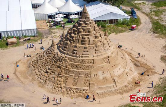 Sculptors work on sand sculpture to challenge Guinness World Record