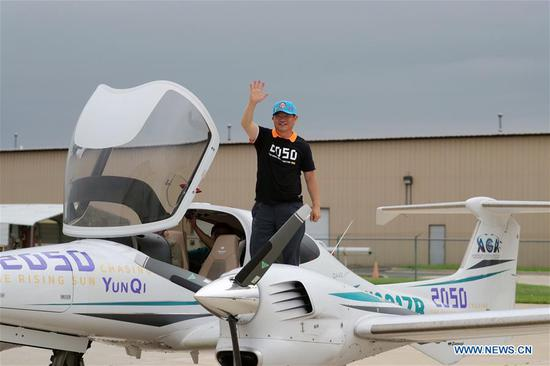 Chinese man completes around-the-world flight, lands in Chicago