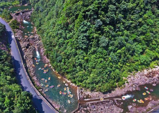 Tourists enjoy drifting at Yucun village, Zhejiang province. (Photo provided to China Daily)