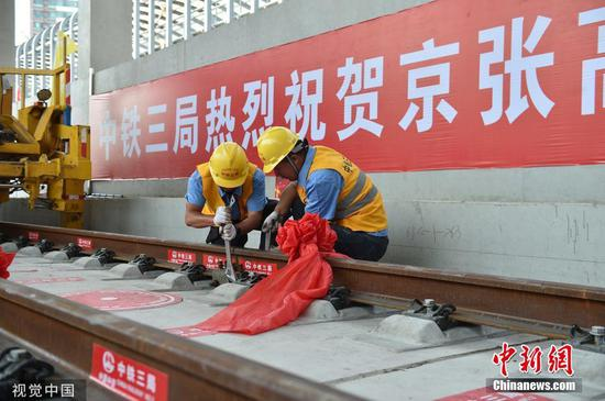 The entire track-laying construction for the Beijing-Zhangjiakou high-speed railway is completed on June 12, 2019. (Photo/VCG)