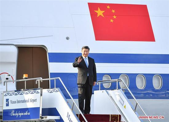 Chinese President Xi Jinping disembarks from the airplane upon his arrival in Bishkek, Kyrgyzstan, June 12, 2019. Xi arrived here Wednesday for a state visit to Kyrgyzstan and the 19th Shanghai Cooperation Organization (SCO) summit. (Xinhua/Yin Bogu)