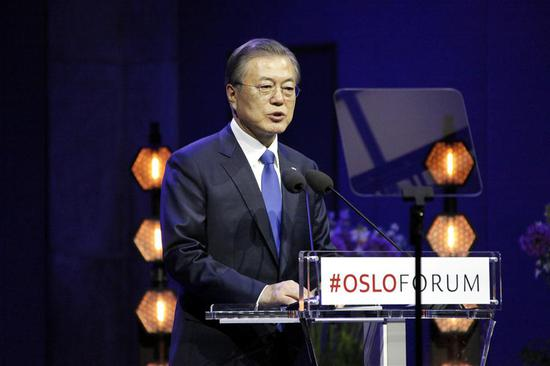 South Korean President Moon Jae-in delivers a speech at the Oslo Forum conference at the University of Oslo in Oslo, Norway, June 12, 2019. South Korean President Moon Jae-in on Wednesday expressed his hope that he will meet with Kim Jong Un, top leader of the Democratic People's Republic of Korea (DPRK), before U.S. President Donald Trump visits Seoul at the end of June. (Xinhua/Liang Youchang)
