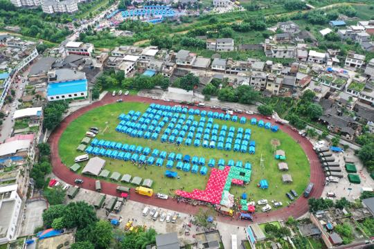 An aerial view of a temporary settlement area in Changning, Sichuan province, after a magnitude 6.0 earthquake and multiple aftershocks hit the region, June 18, 2019. (Photo by Hu Peng/chinadaily.com.cn)
