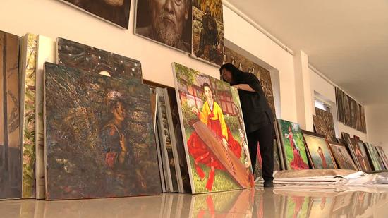 Art pieces show long, close China-DPRK friendship