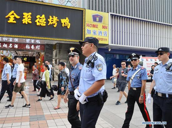 Chinese and Italian police officers patrol the Wangfujing street in Beijing, capital of China, June 24, 2019. The joint patrol, the third such exercise between Chinese and Italian police in China, will last until July 5 in four cities: Beijing, Shanghai, Chongqing and Guangzhou. The joint patrol is reciprocal. Since May 2016, China has sent three groups of police officers to patrol streets in Italy. Italian officers were first invited to jointly patrol Beijing and Shanghai in April 2017. (Xinhua/Yin Gang)