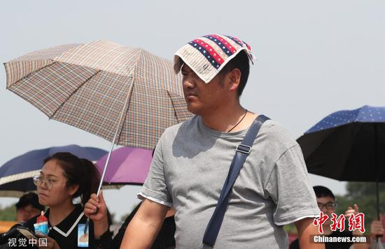 Beijing continues to issue alert for high temperatures