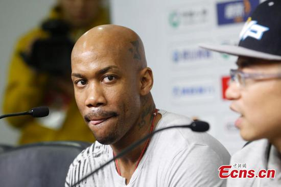 Former NBA star Stephon Marbury meets the press before playing in his last-ever game in the China Basketball Association's regular-season finale in Beijing, Feb. 11, 2018.(Photo: China News Service/Han Haidan)