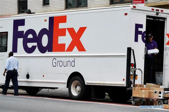 A FedEx delivery truck is pictured in Manhattan, New York, the United States, June 25, 2019. U.S. courier delivery company FedEx Corp. on Monday sued the U.S. Department of Commerce over a request that the package giant enforce restrictions on Chinese telecom equipment provider Huawei. (Xinhua/Li Muzi)