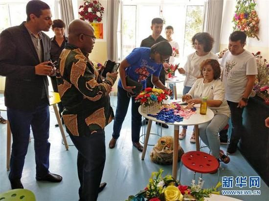 Diplomats and representatives based in Geneva from 14 countries and an organization are visiting Kashi Vocational Education and Training Center, in Kashi, Xinjiang Uygur Autonomous Region, on June 20, 2019. [Photo: Xinhua]