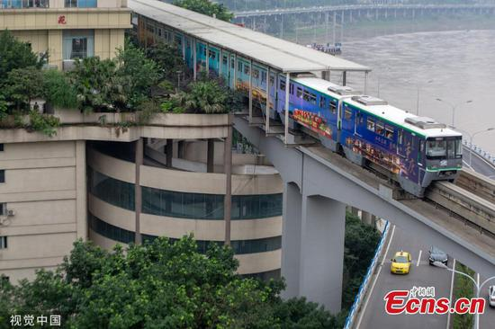 Train passes over spiral car park in 'mountain city'