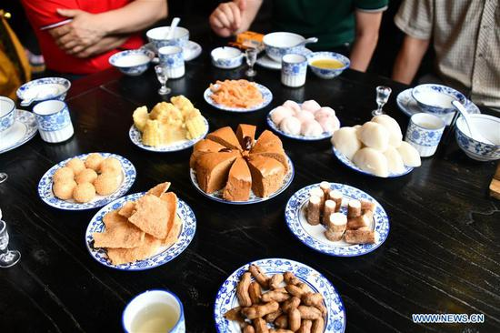 Distinctive etiquette of banquet for Gelao people in SW China