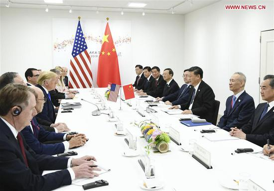 Chinese President Xi Jinping meets with U.S. President Donald Trump in Osaka, Japan, June 29, 2019. (Photo: Xinhua)