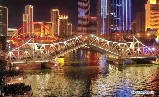 Tianjin's Jiefang Bridge opens itself on July 1