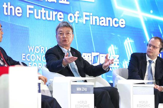 Zhu Min, head of Tsinghua University's National Institute of Financial Research, speaks during the ongoing Summer Davos Forum in Dalian, Liaoning province. [Photo by Zou Hong/China Daily]