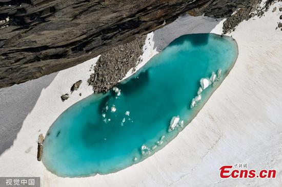Melting ice forms lake in Alps as temperatures soar in Europe